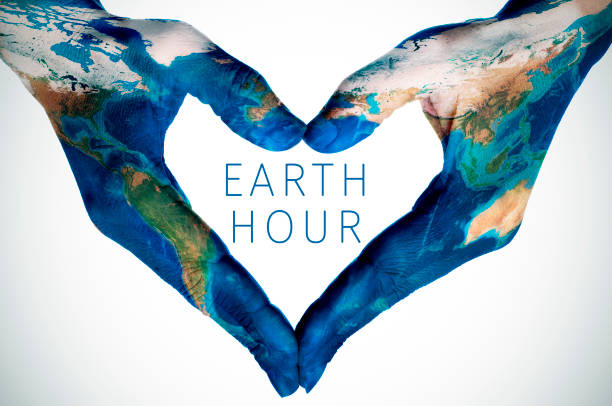 text earth hour and woman hands patterned with world map (furnished by NASA) the text earth hour and the hands of a young woman, patterned with a world map (furnished by NASA), forming a heart environmental consciousness stock pictures, royalty-free photos & images