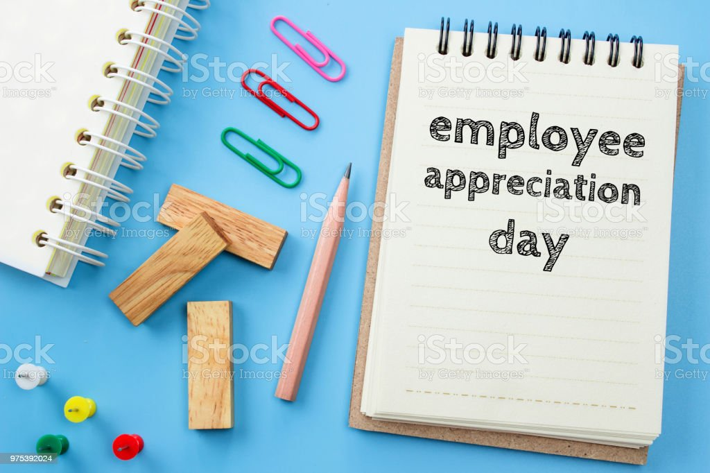 Text Employee appreciation day on white paper book and office supplies on blue desk / business concept stock photo