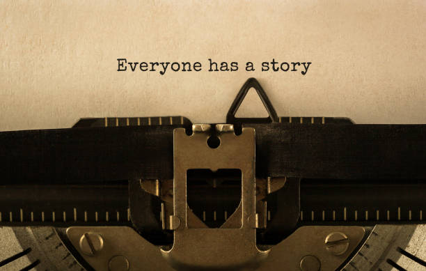 Text Everyone has a story typed on retro typewriter stock photo