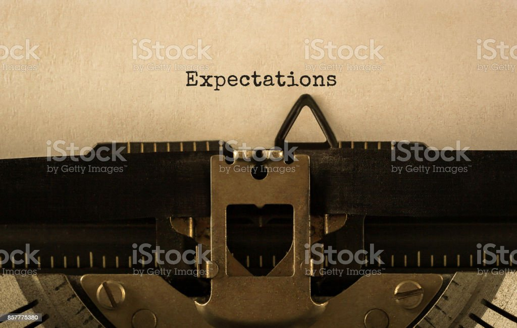 Text Expectations typed on retro typewriter stock photo