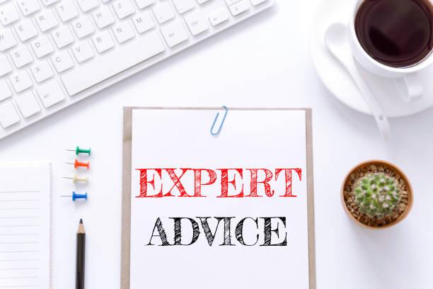 text expert advice on white paper background / business concept. - klavier verkaufen stock-fotos und bilder