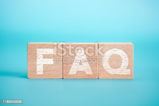 istock Text FAQ With Wooden Block On The Blue Background 1183040030