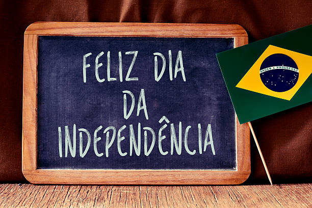 text Feliz Dia da Independencia and Brazilian flag stock photo