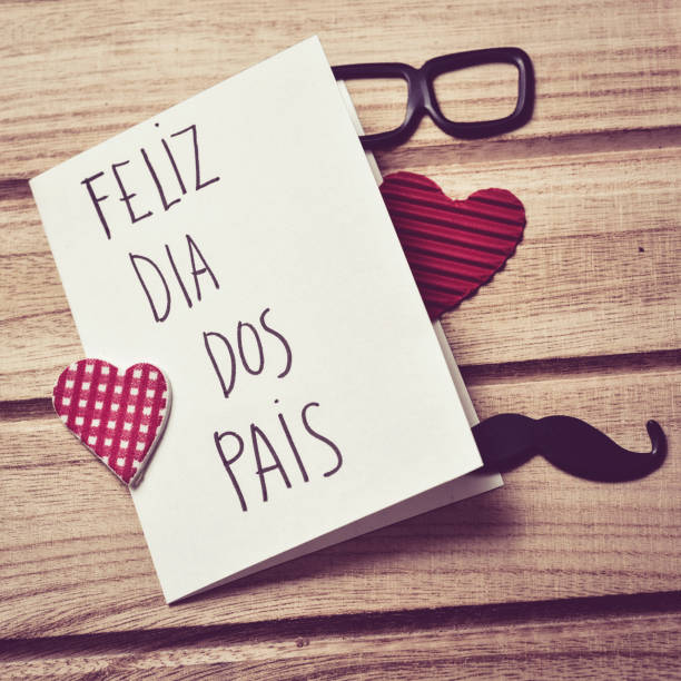 text feliz dia dos pais, happy fathers day in Portuguese stock photo
