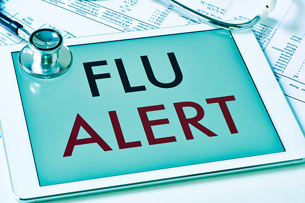 text flu alert in a tablet computer stock photo