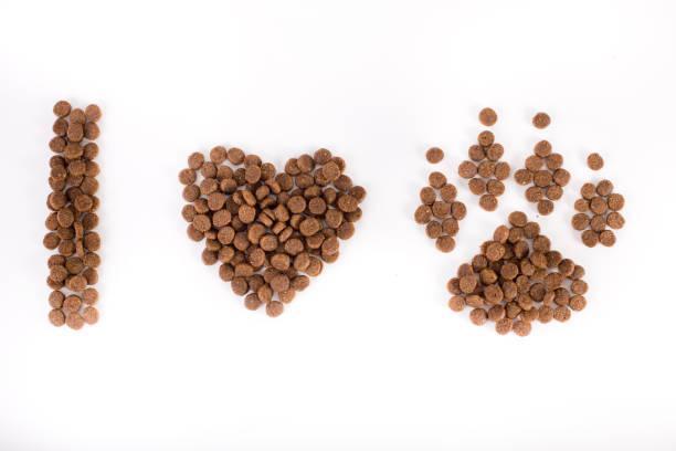 text from dog's granules - dog food imagens e fotografias de stock