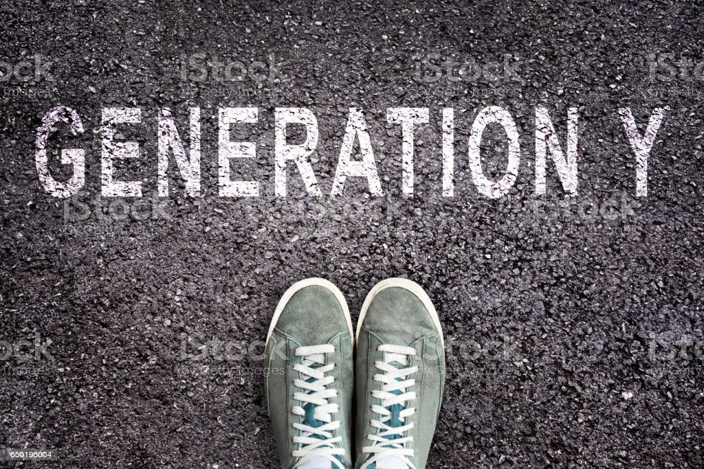 Text Generation Y written on asphalt with shoes stock photo