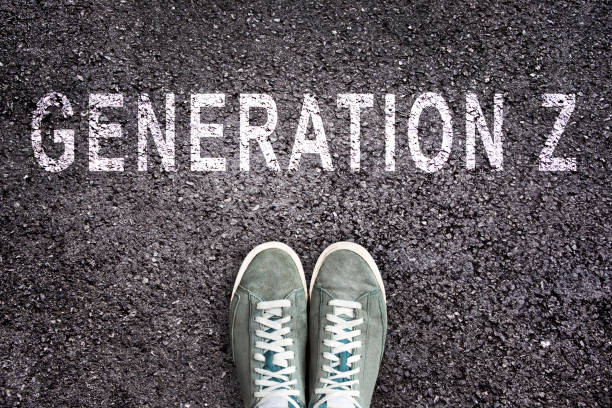 Text Generation Z written on asphalt with shoes, generation Z concept Text Generation Z written on asphalt with shoes, generation Z concept generation z stock pictures, royalty-free photos & images