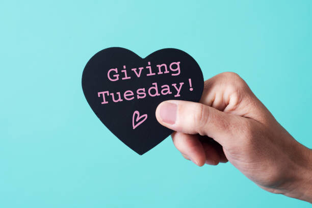 text giving tuesday in a heart-shaped sign stock photo
