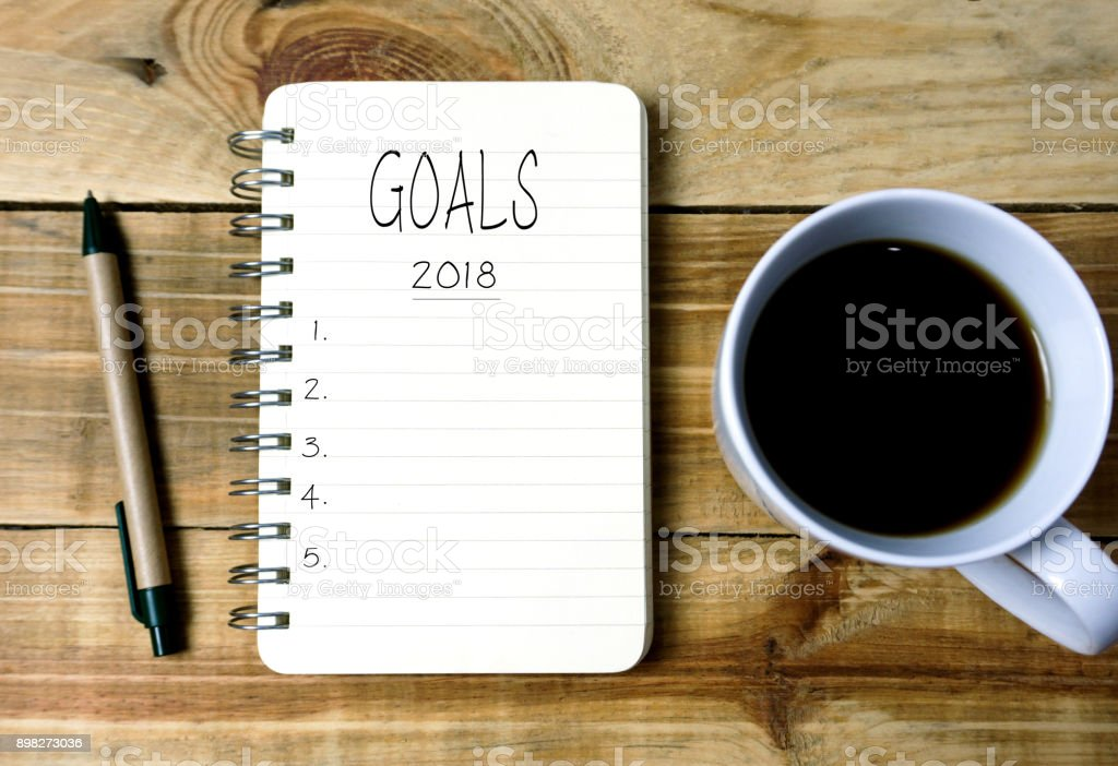 Text Goals 2018 on Notepad With Cup of Coffee stock photo