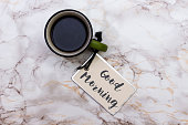 istock text GOOD MORNING on tag with cup of aromatic coffee 1179146565