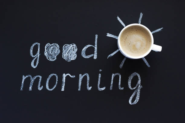 text good morning, sun chalk on black background, cup of coffee, meringue - monday motivation stock photos and pictures