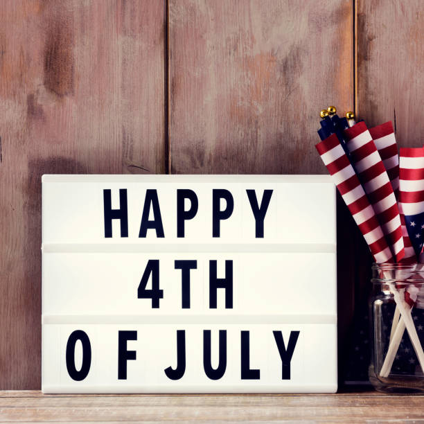 text happy 4th of july and american flags stock photo