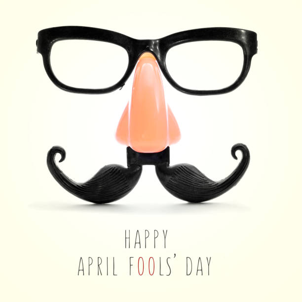 text happy april fools day fake eyeglasses, nose and mustache and the text happy april fools day in a beige background, with a retro effect april fools day stock pictures, royalty-free photos & images