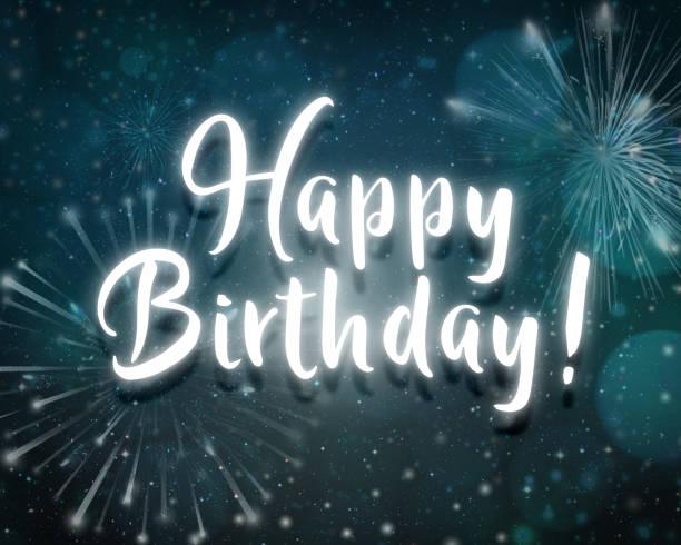 Text Happy birthday neon light in dark sky with firework congratulations card stock photo