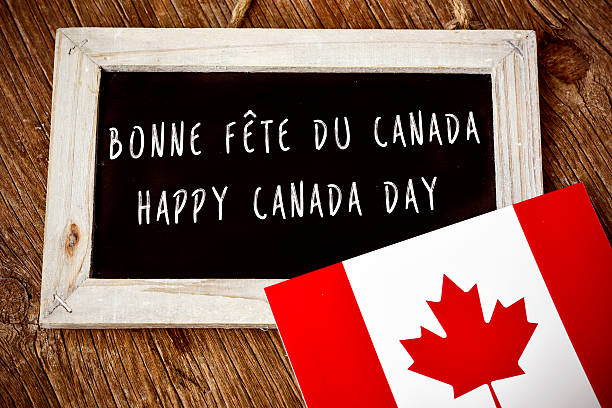 text happy canada day in french and english - canada day stock pictures, royalty-free photos & images