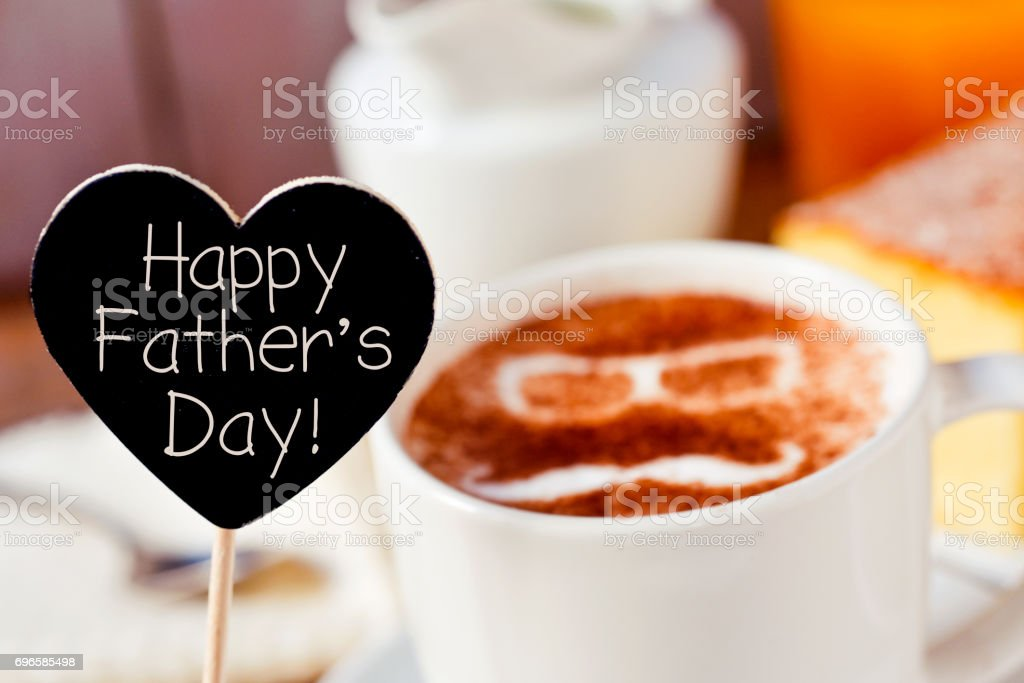 text happy fathers day and a cup of cappuccino stock photo