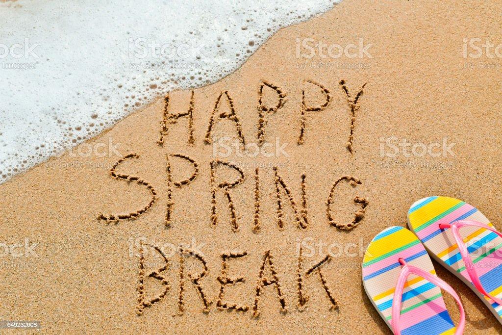 text happy spring break in the sand stock photo