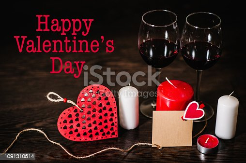 istock Text happy Valentine's Day. Love concept with candle, wine, red hearts. Valentines day background. Space for text. letters on empty paper sheet, note for text message. Empty greeting card. 1091310514