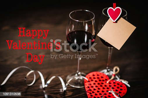 istock Text happy Valentine's Day. Love concept with wine, red hearts. Valentines day background. Space for text. letters on empty paper sheet, note for text message. Empty greeting card. 1091310538