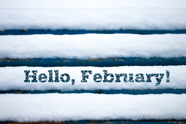 text hello february on old wood texture with snow - february stock photos and pictures