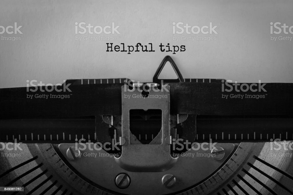 Text Helpful tips typed on retro typewriter stock photo