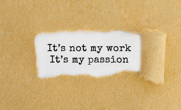 text it's not my work it's my passion appearing behind ripped brown paper. - passion stock pictures, royalty-free photos & images