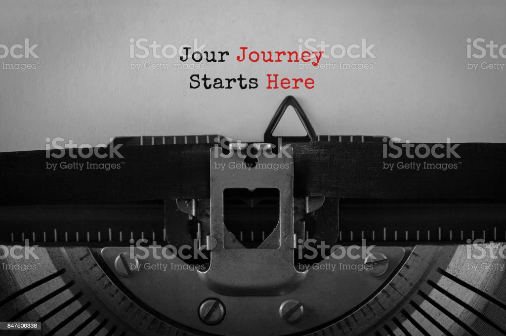 Text Jour Journey Starts Here typed on retro typewriter stock photo