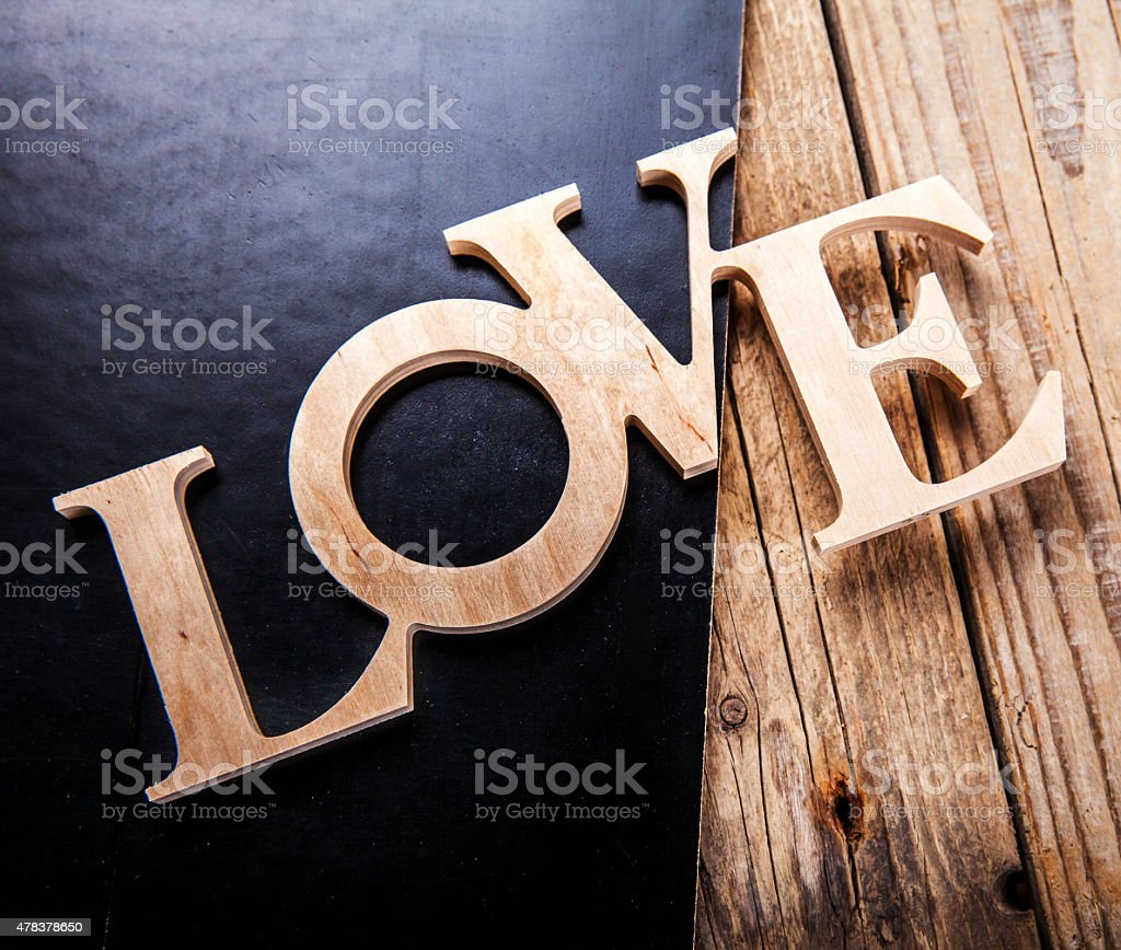 text love on black background stock photo