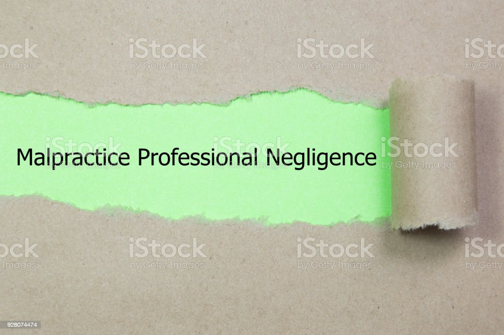 Text Malpractice Professional Negligence appearing behind ripped paper. stock photo