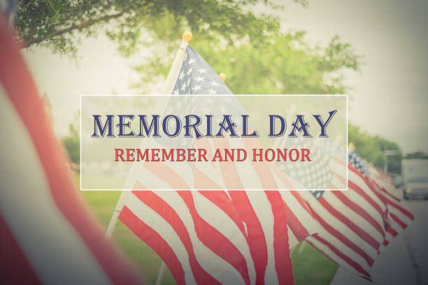 Text Memorial Day and Honor on row of lawn American Flags Text Memorial Day and Honor on long row of lawn American Flags background. Green grass yard USA flags blow in the wind. Concept of Memorial day or Veteran's day in America. memorial day stock pictures, royalty-free photos & images