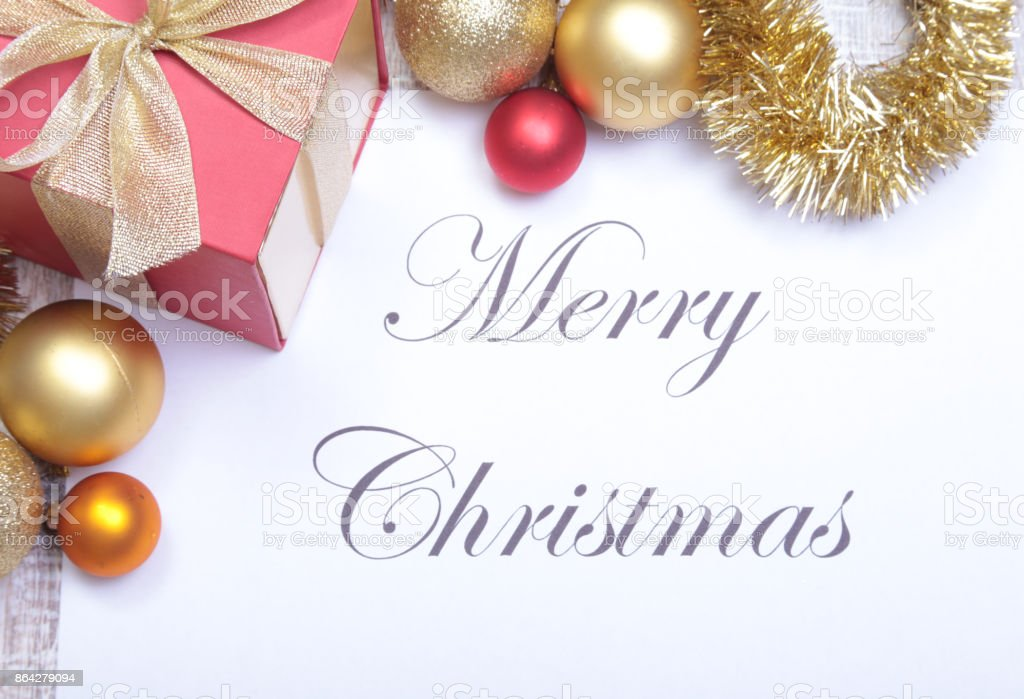 Text merry christmas on paper with many balls royalty-free stock photo