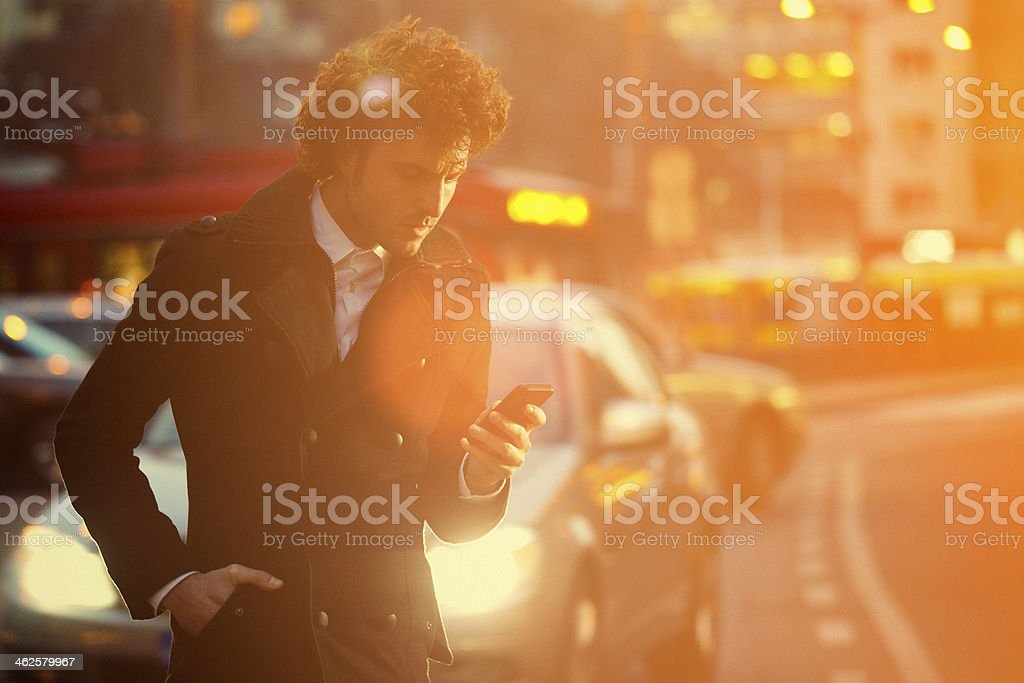 Text messaging in the middle of trafic jam royalty-free stock photo