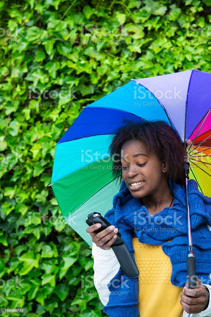 Text messaging under the rain royalty-free stock photo