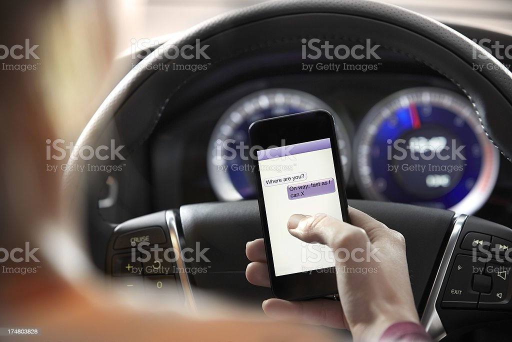 Text messaging while driving stock photo