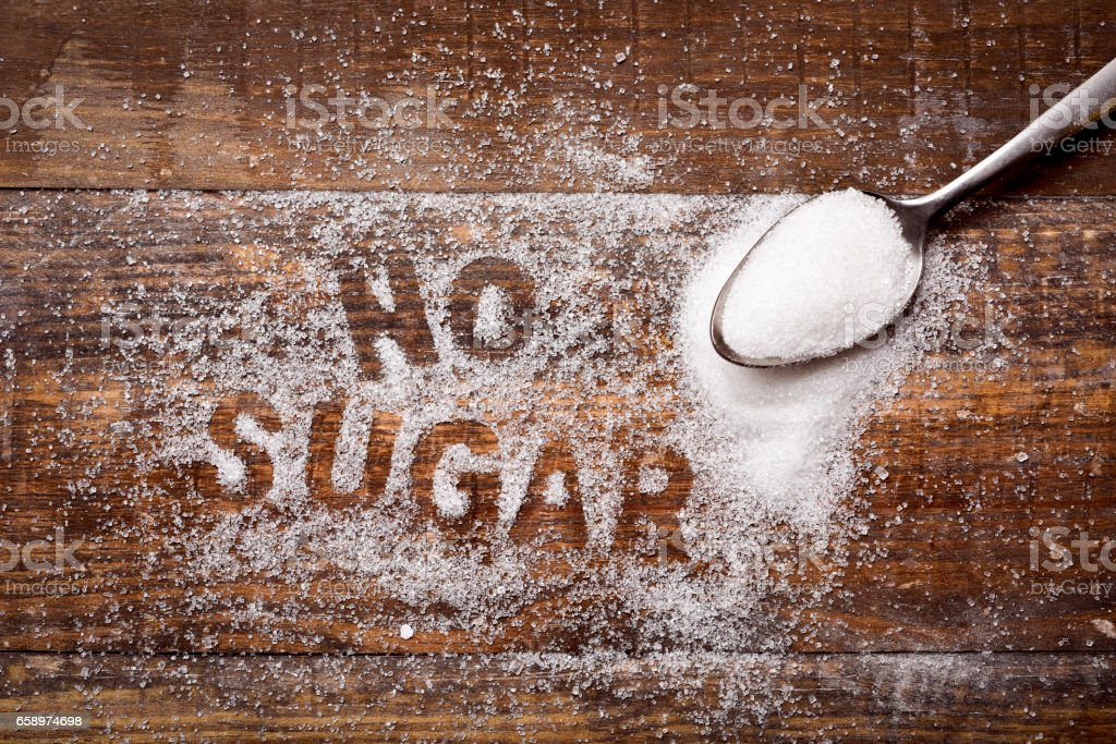 text no sugar written with sugar stock photo