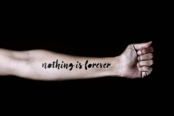 text nothing is forever in a forearm - männer zitate stock-fotos und bilder