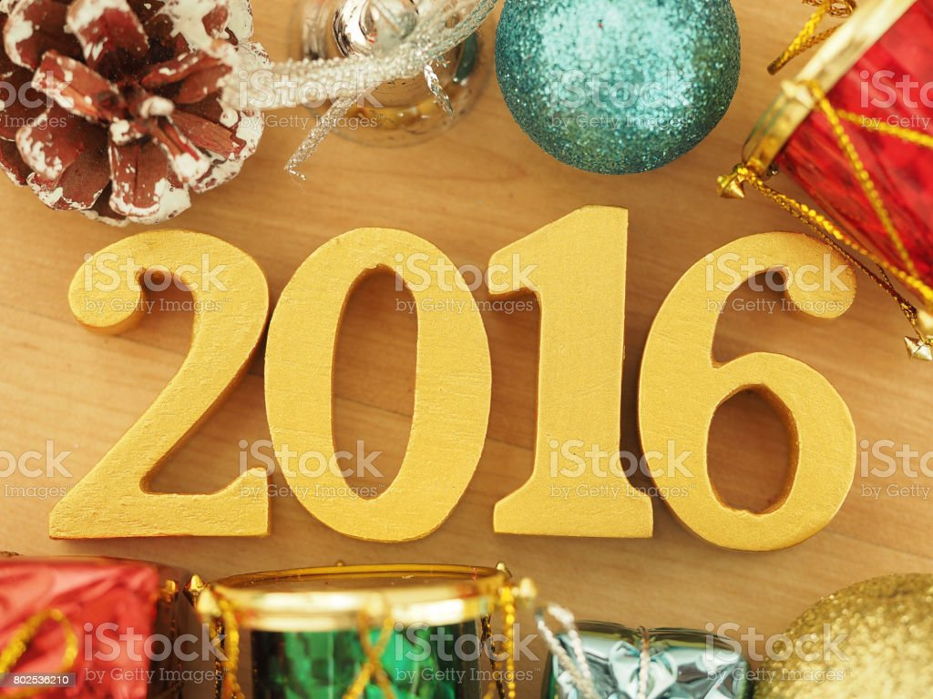 Text of gold 2016, make from wood. Golden year 2016. New year...
