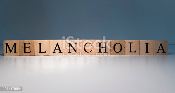 1091817198 istock photo Text of melancholia from wooden cubes. psychological terms and health problems. 1254479554