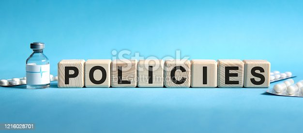 508610235 istock photo POLICIES - text on cubes. Drug in ambula, tablets in blisters to reduce disease symptoms 1216028701