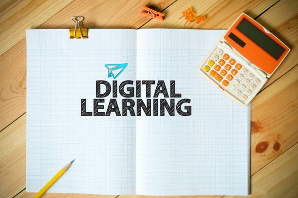 DIGITAL LEARNING text on paper in the office stock photo