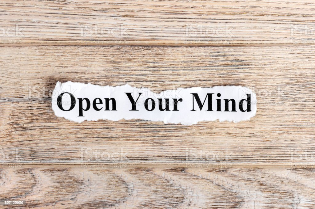 OPEN YOUR MIND text on paper. Word OPEN YOUR MIND on torn paper. Concept Image stock photo