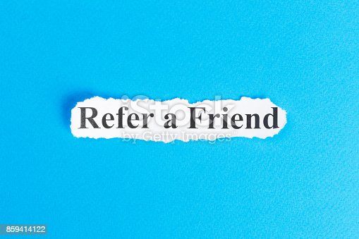 istock REFER A FRIEND text on paper. Word REFER A FRIEND on torn paper. Concept Image 859414122