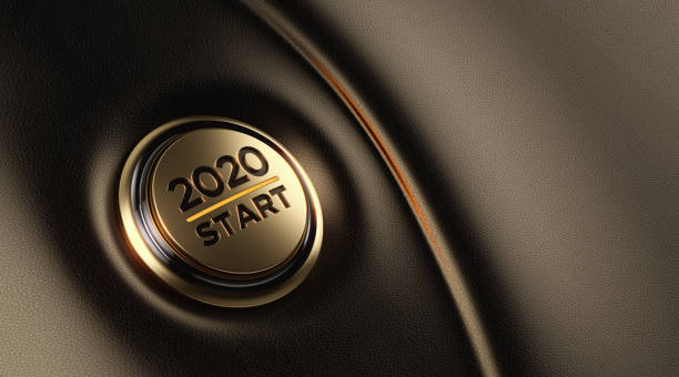 2020 text on reflective surface over defocused background - new years day stock pictures, royalty-free photos & images