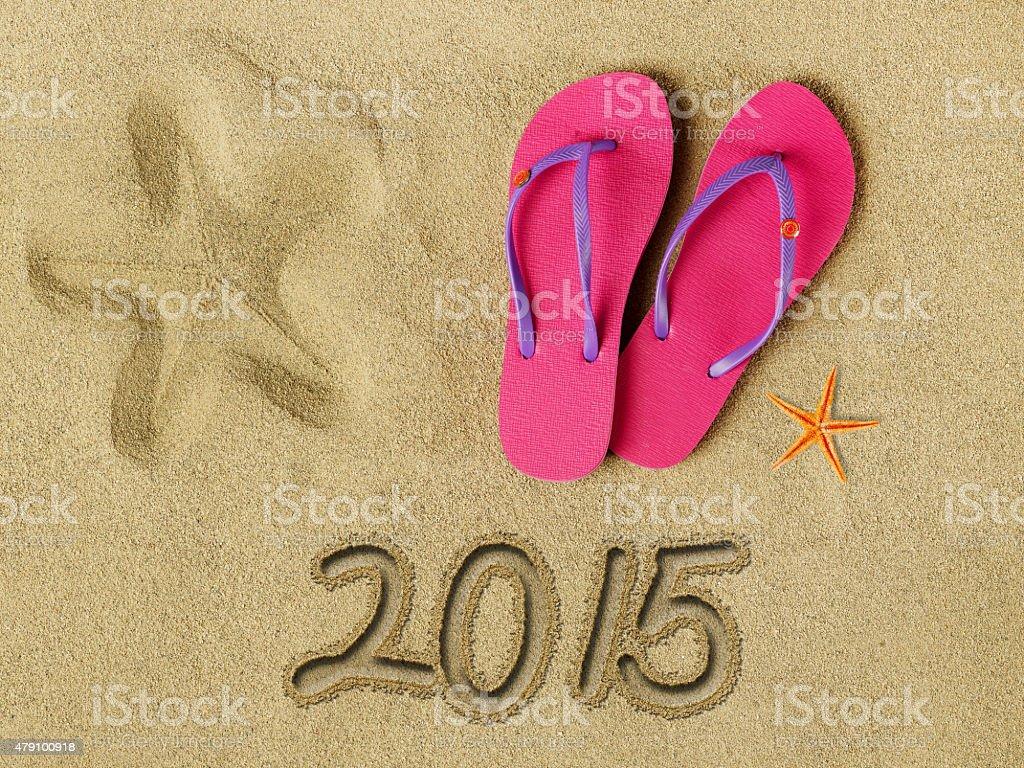 2015 text on sand stock photo