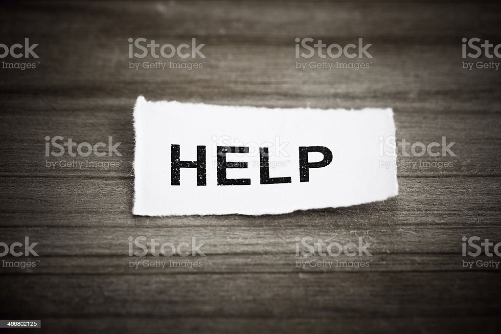 'HELP' text on wood background royalty-free stock photo