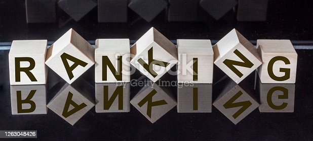 RANKING text on wooden cubes and black glass surface