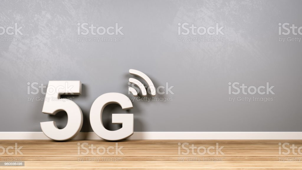 5G Text on Wooden Floor Against Wall stock photo
