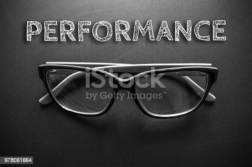 Text performance with eyeglasses on black background / business concept / dark tone