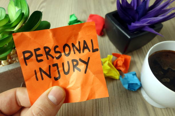 Text personal injury handwritten on sticky note stock photo